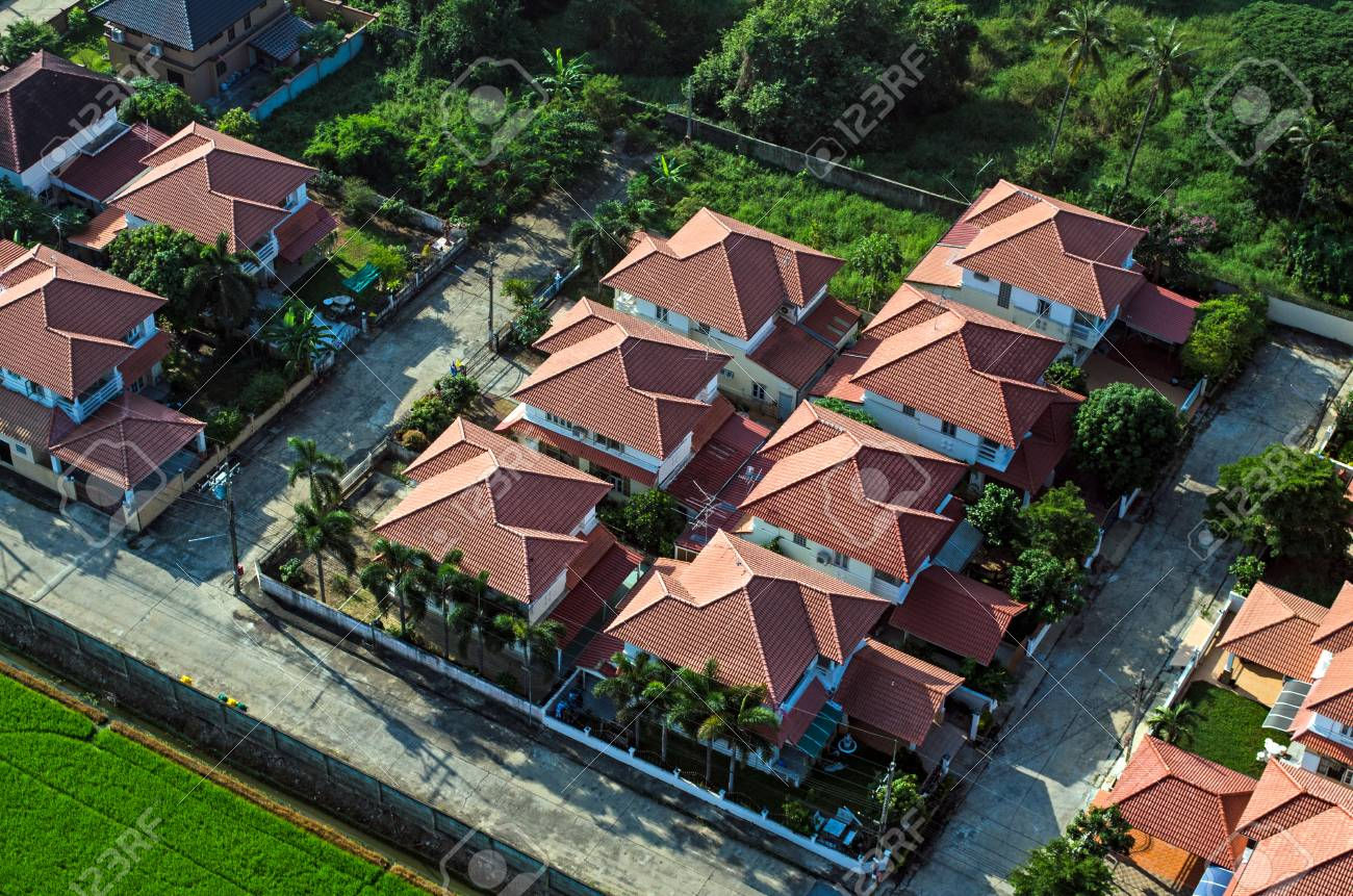 Red roofs in residential area housing, view from the air - 77213462