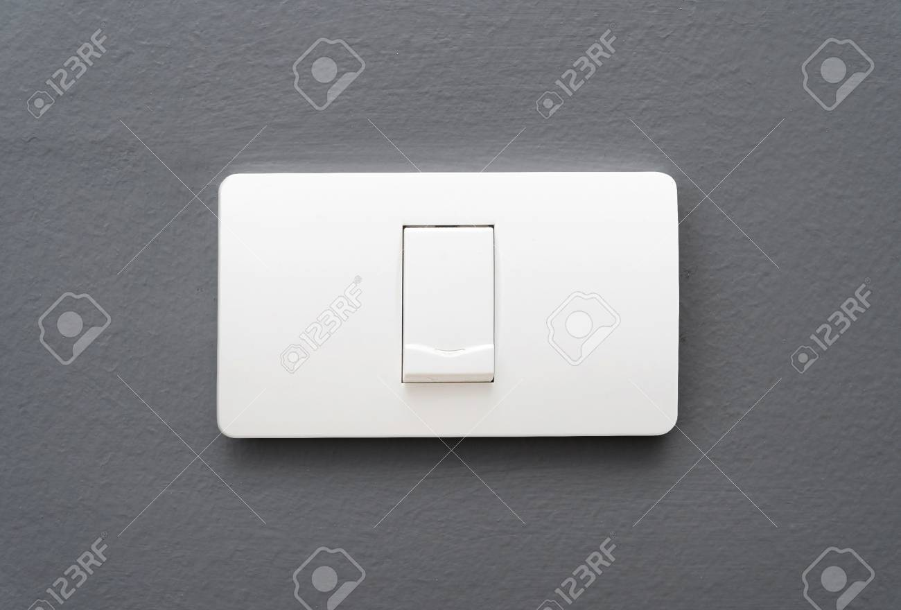Single Light Switch On Gray Concrete Wall Background. Stock Photo ...