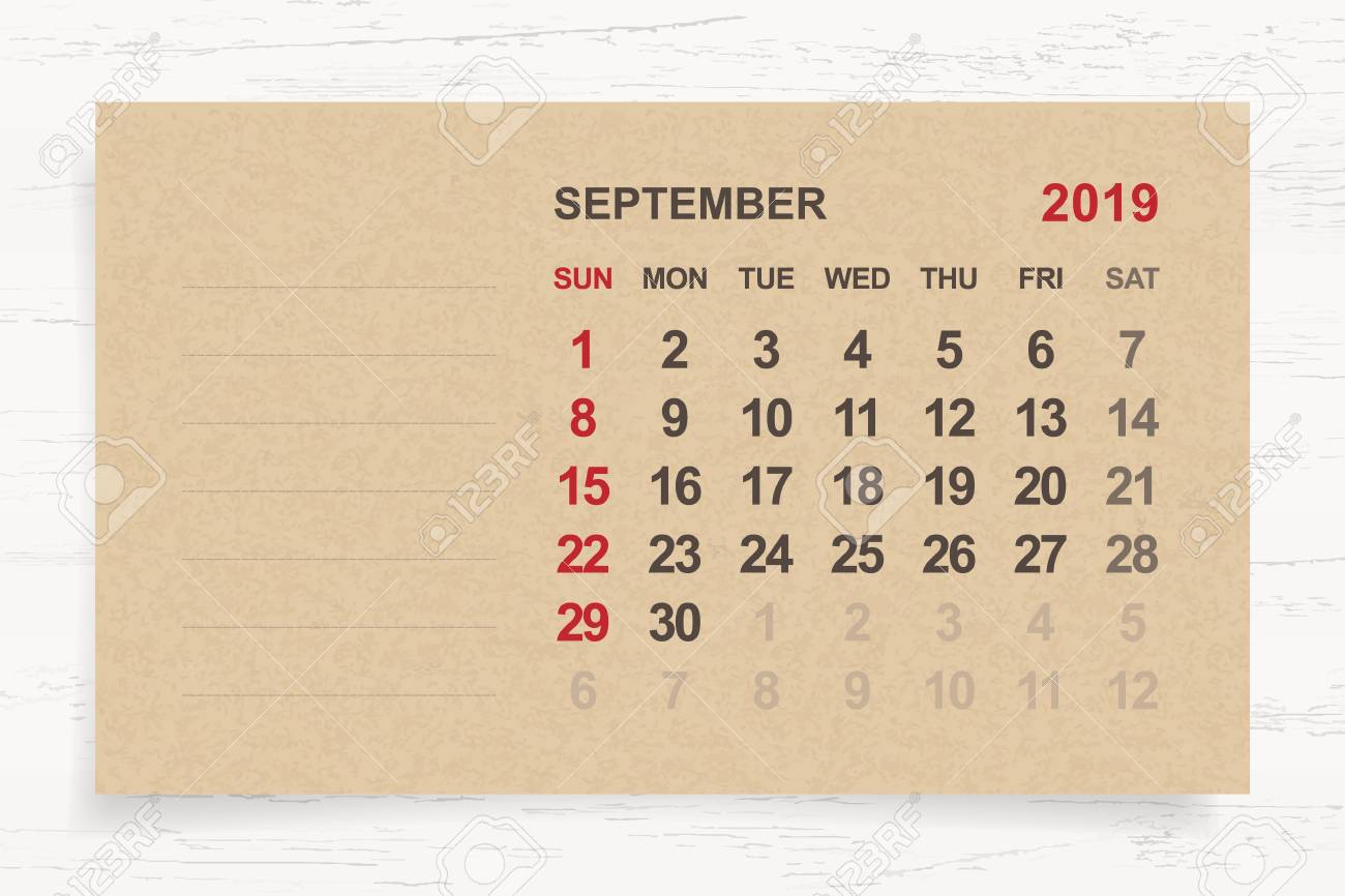 September 2019 Monthly Calendar On Brown Paper And Wood Background