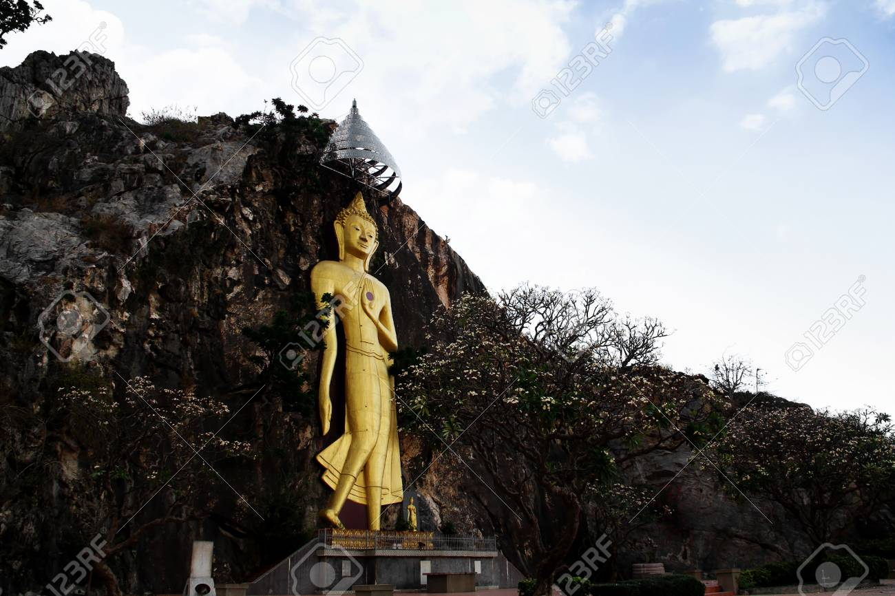 golden buddha carved on the cliff in Ratchaburi province ,Thailand Stock Photo - 13712437