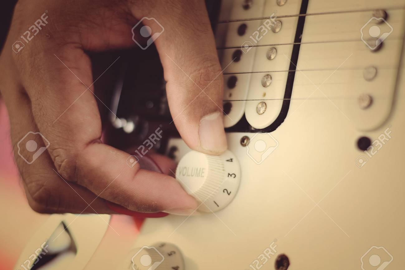 hand on volume control Stock Photo - 24340743