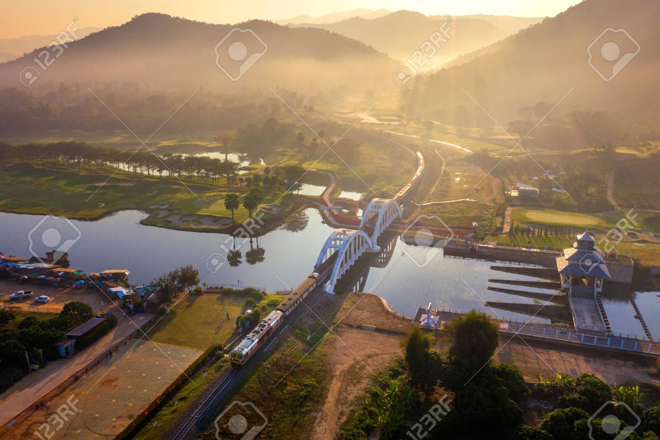 Aerial of Thachomphu Railway Bridge or White Bridge in Lamphun, Thailand. - 117779440