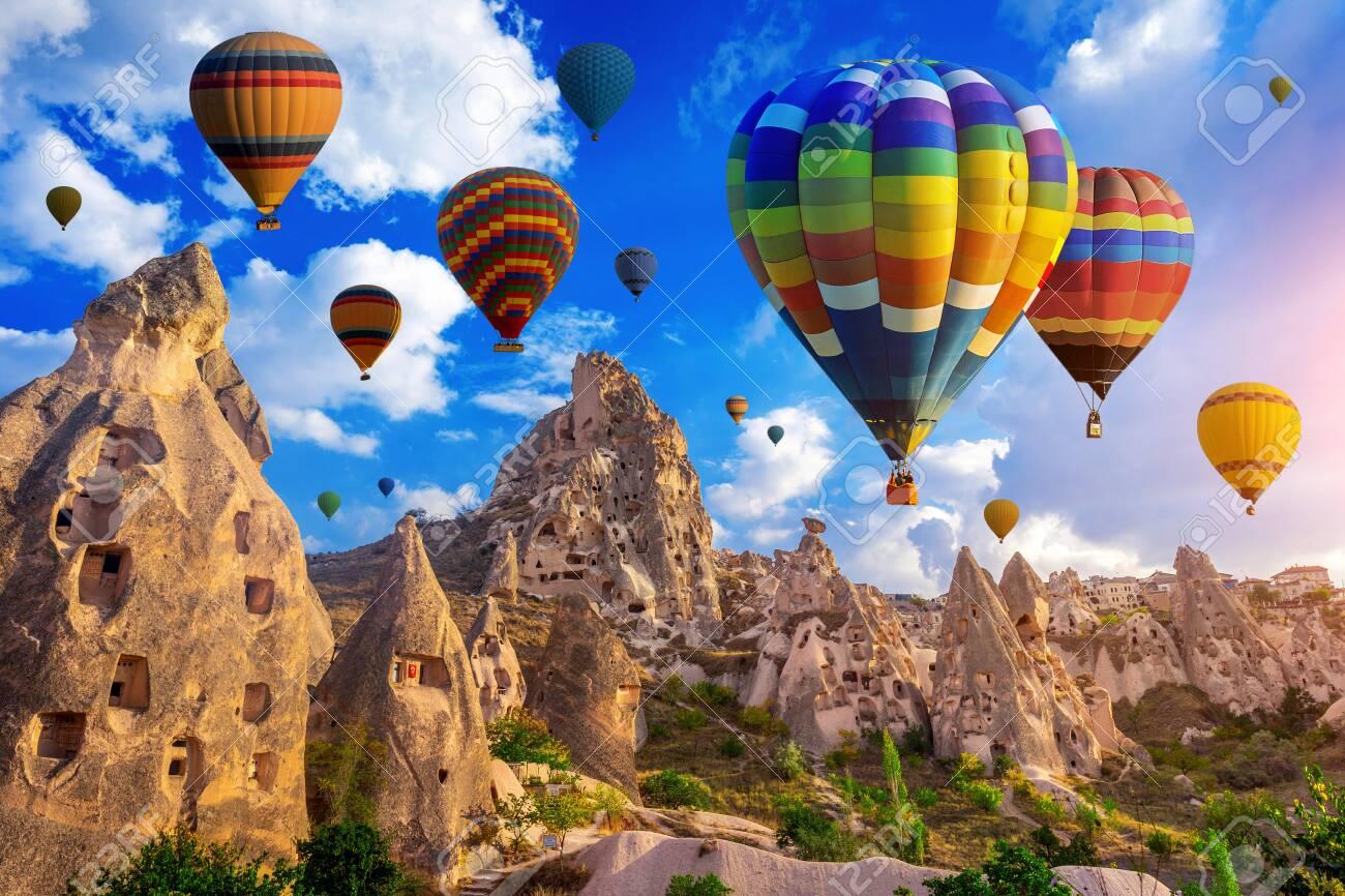 Colorful hot air balloon flying over Cappadocia, Turkey. - 136223064
