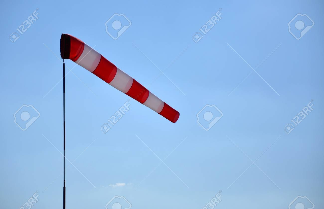 Windsock indicating wind with blue sky and with place for your text Stock Photo - 16031688