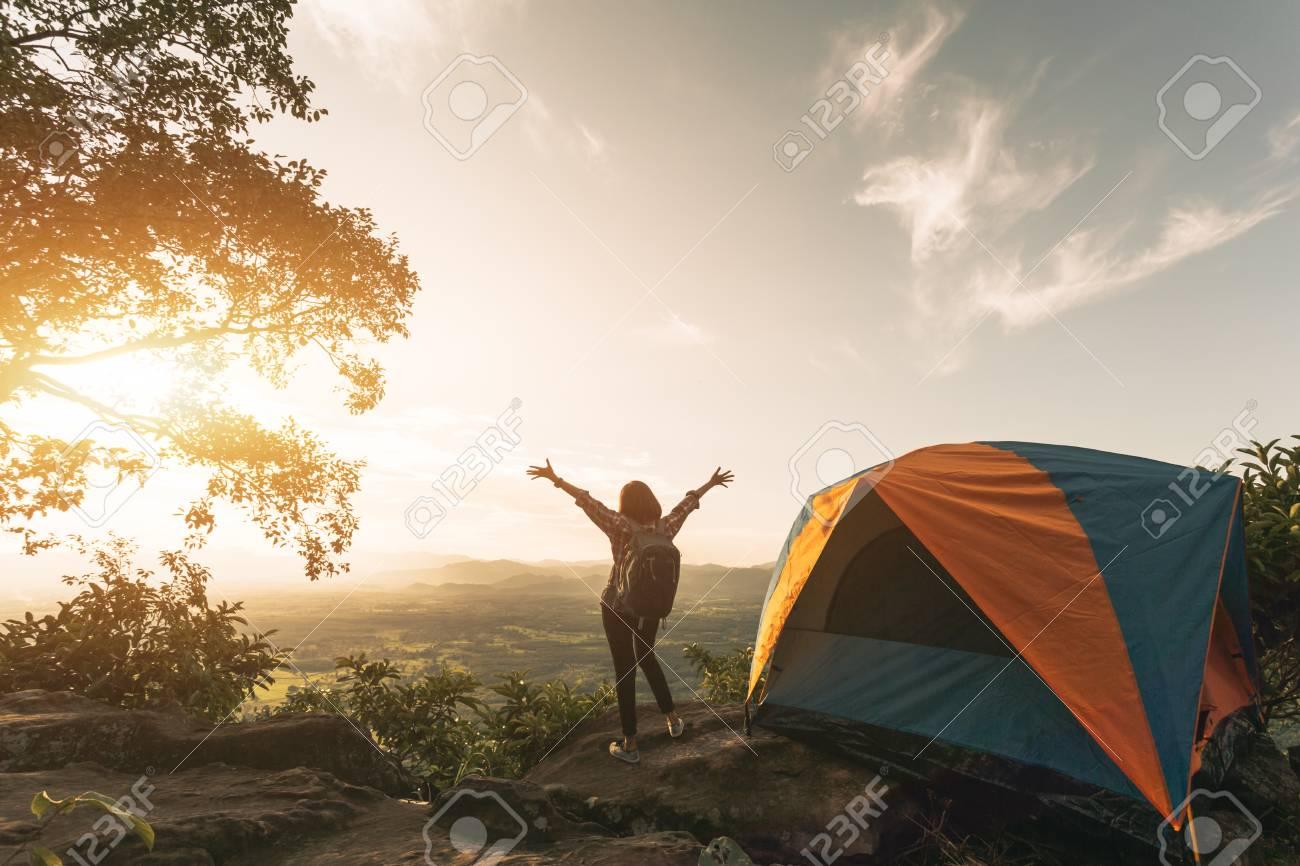 Asian Hiker woman standing near c&ing tent in carpathian mountains. Tourist enjoy mountain view in & Asian Hiker Woman Standing Near Camping Tent In Carpathian Mountains ...