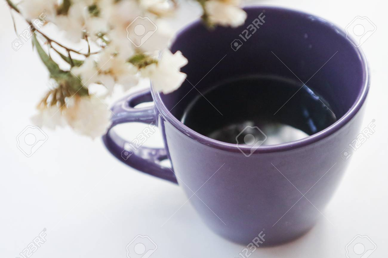 Isolated Purple Cup Of Coffee With A Spring Bouquet Of White Stock Photo Picture And Royalty Free Image Image 109917341
