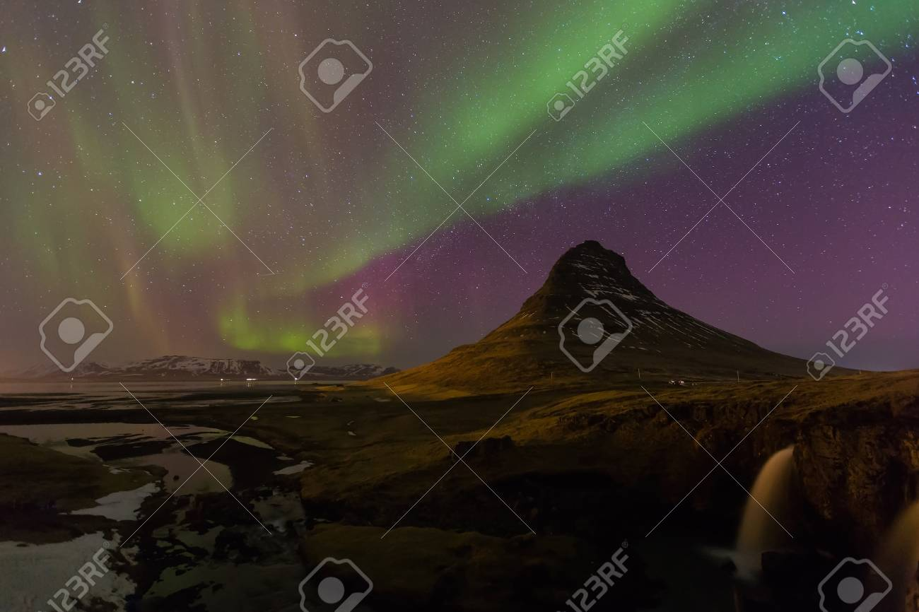 Northern Lights   Aurora Borealis Over Kirkjufell Volcano, Iceland Winter  Season Landscape Stock Photo