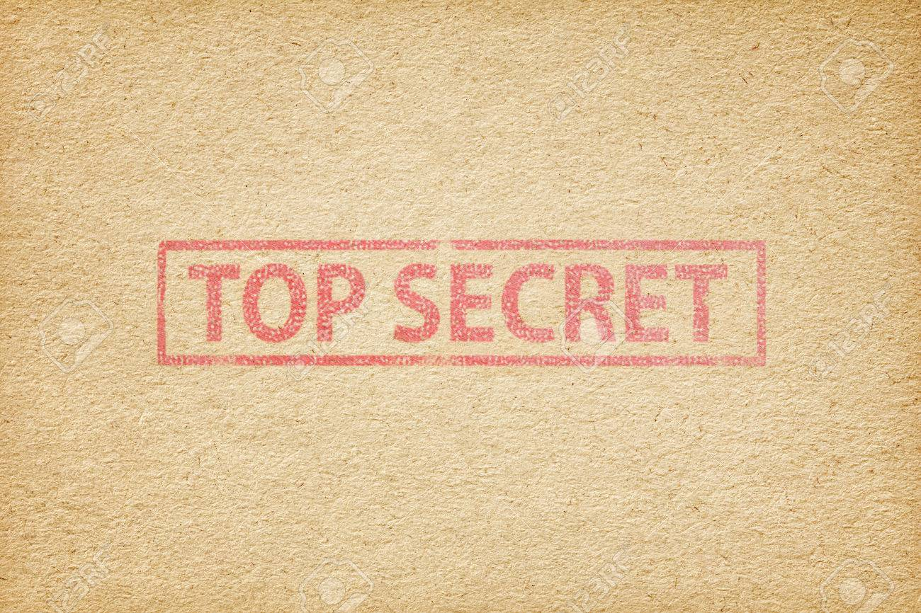 Top Secret Stamp On The Brown Paper Background Stock Photo Picture