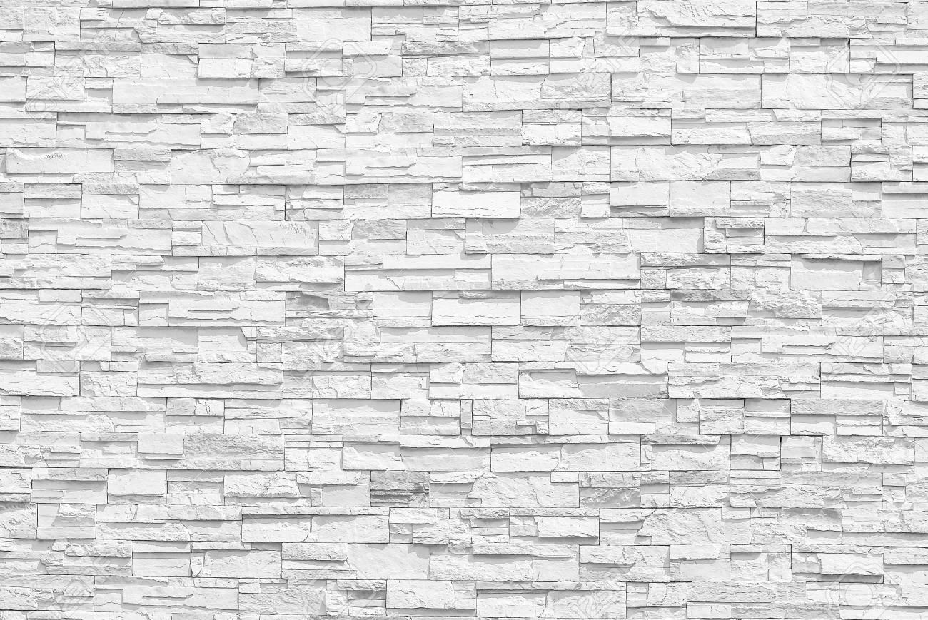 Weiße Steinwand weiße wand der oberfläche der grauen töne der steinwand für gebrauch