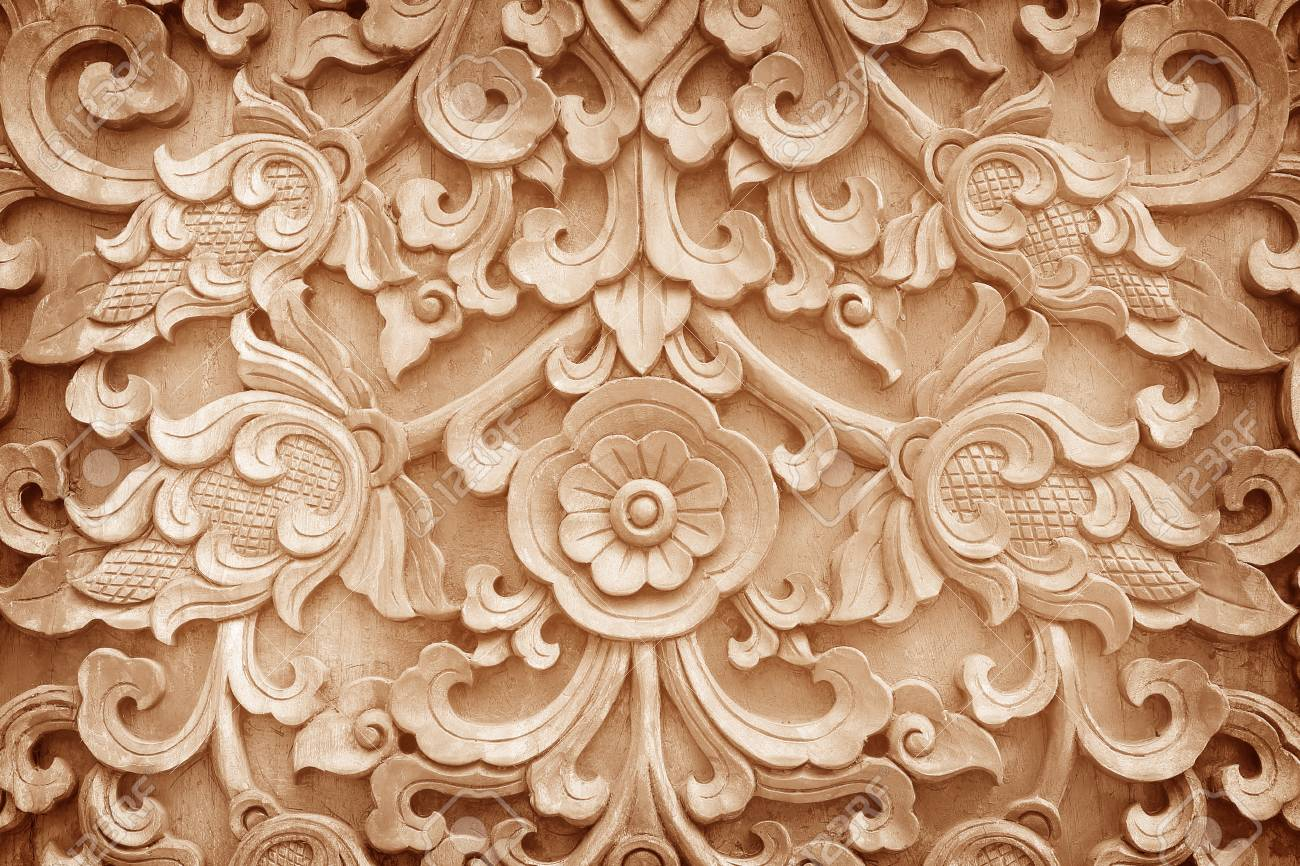 photo pattern of flower carved on wood background