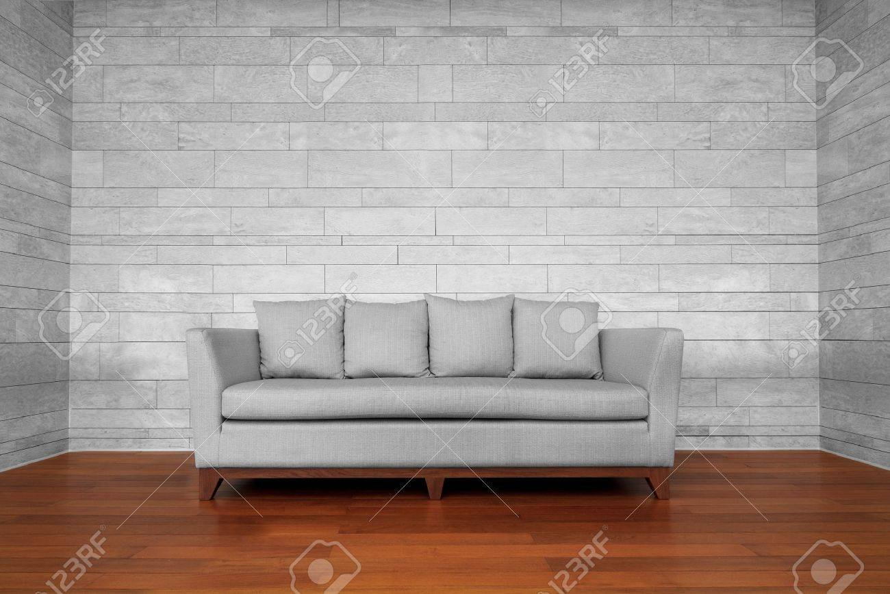 Gray couch chair on brown wooden floor and white wall Stock Photo - 16220993