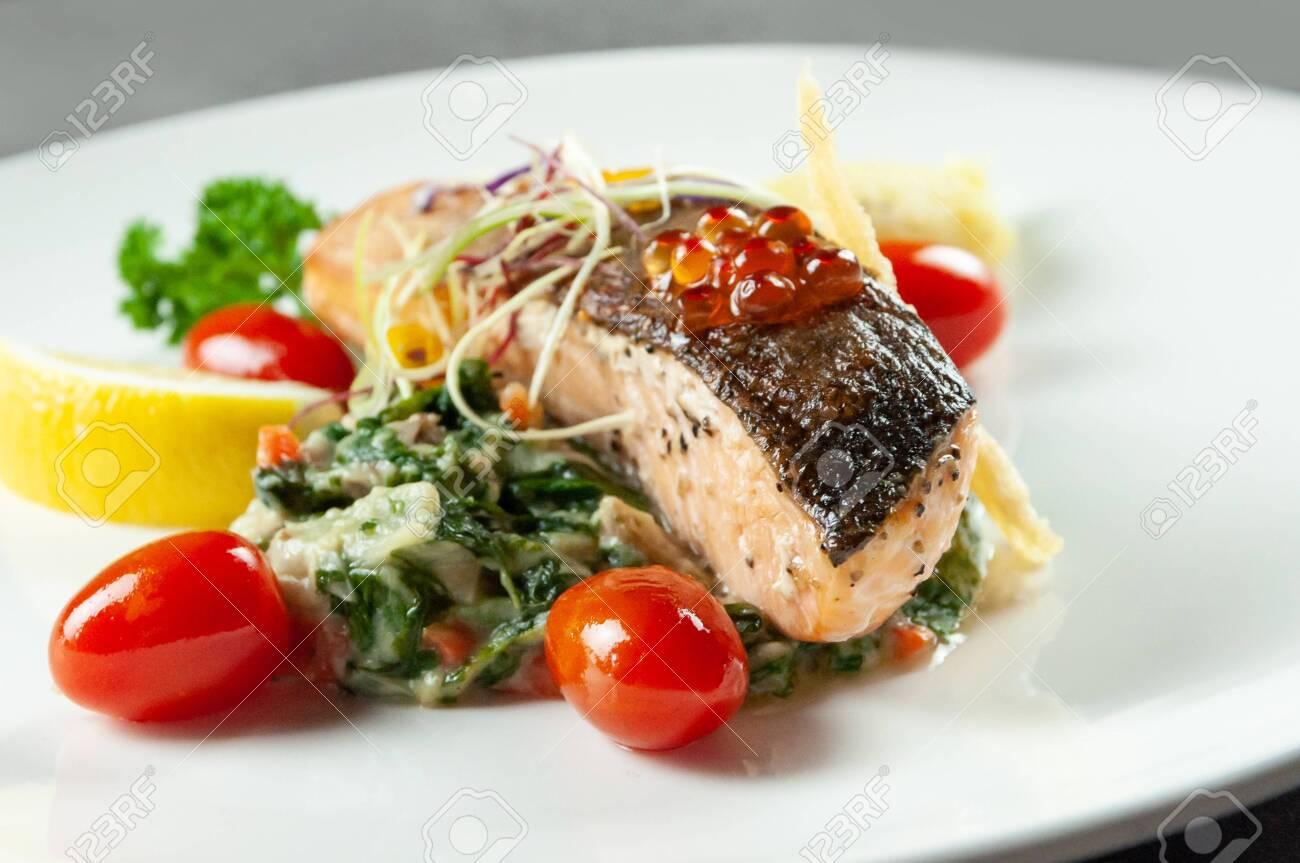 Tasty friend salmon, Grilled Salmon Steak with Spinach - 142709823