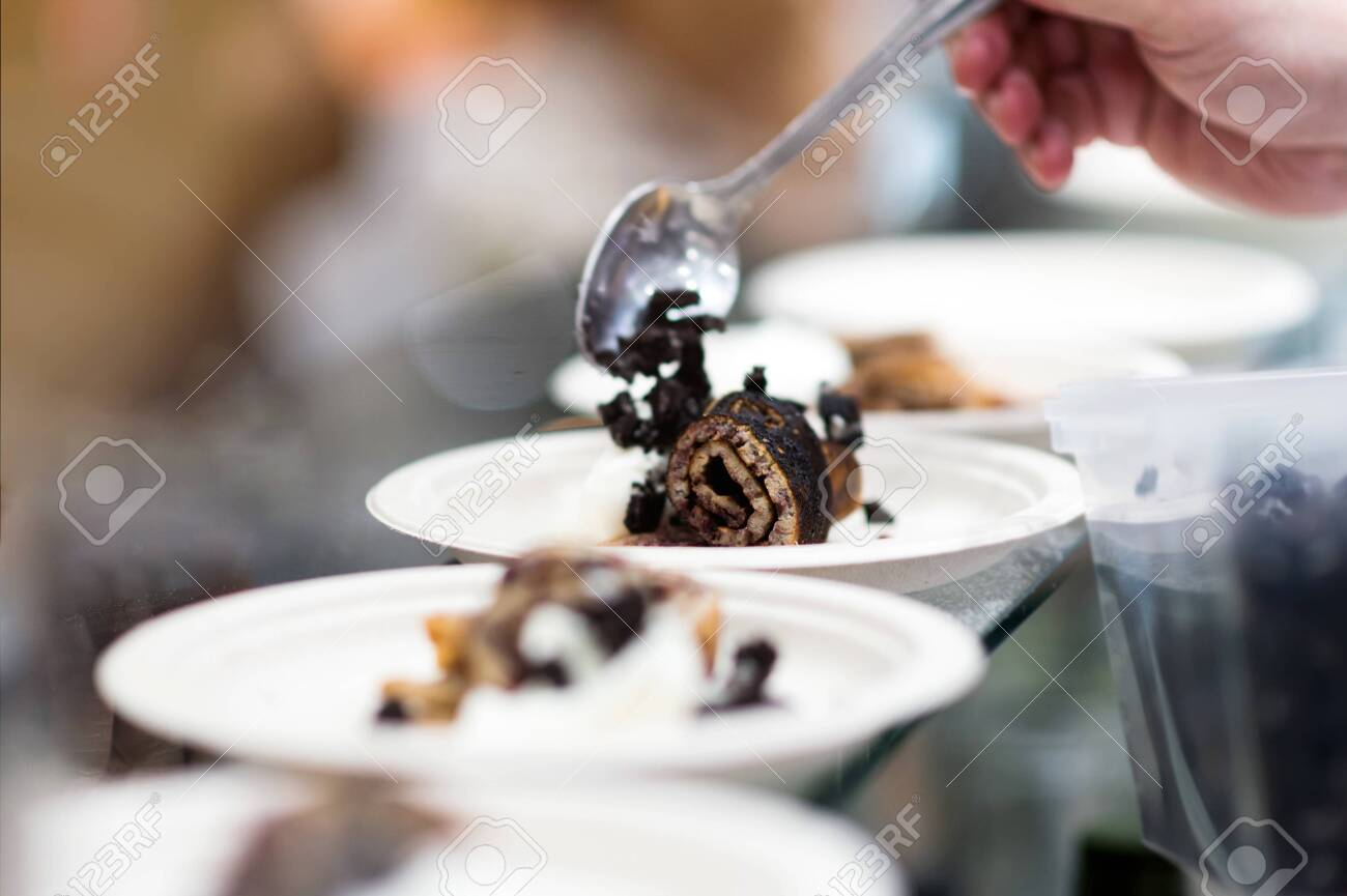 Chef cooking, Chef preparing food in the kitchen, Chef decorating dish, closeup - 148137010