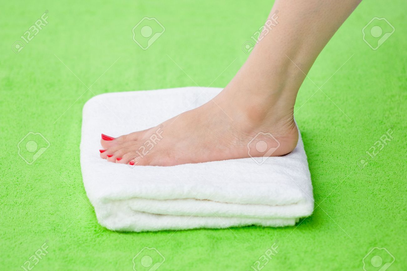 Beautiful Women Feet Pint With Red Nail Polish Over White Towel ...