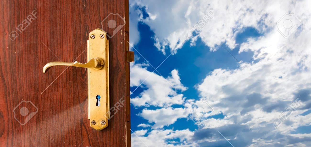 Open door against blue sky; opportunities, new beginning, launch, success, freedom concepts Stock Photo - 6566935