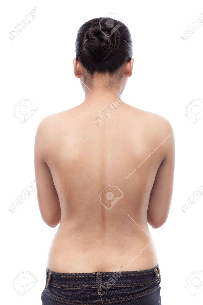 Young indian woman showing her smooth skinned back and wearing blue jeans, isolated on white Stock Photo - 19793378