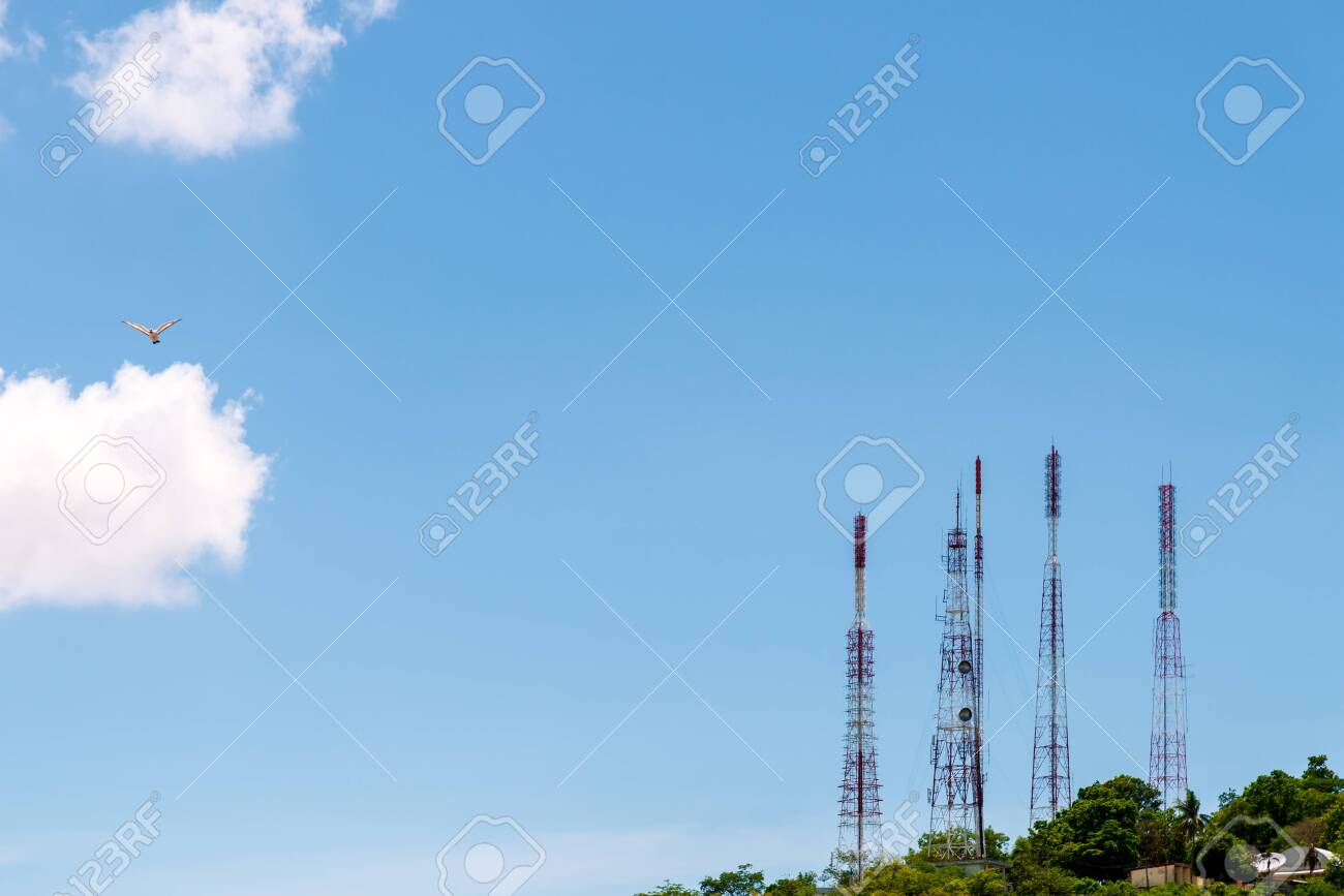 Telecommunication tower antenna and satellite dish on mountain - 129265877