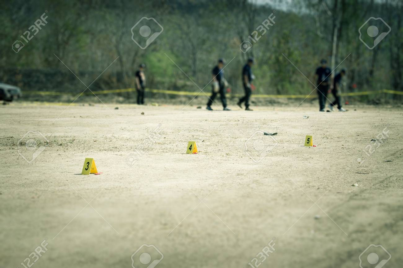 Evidence Marker With Blurred Forensic And Law Enforcement Team Stock Photo Picture And Royalty Free Image Image 73488510
