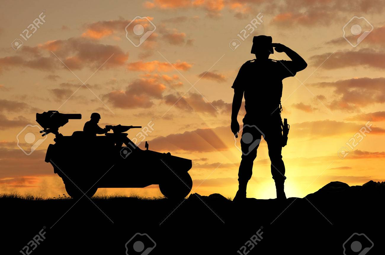 17ebff8ff5 Silhouette of a soldier and a combat vehicle Humvee at sunset Stock Photo -  45646339