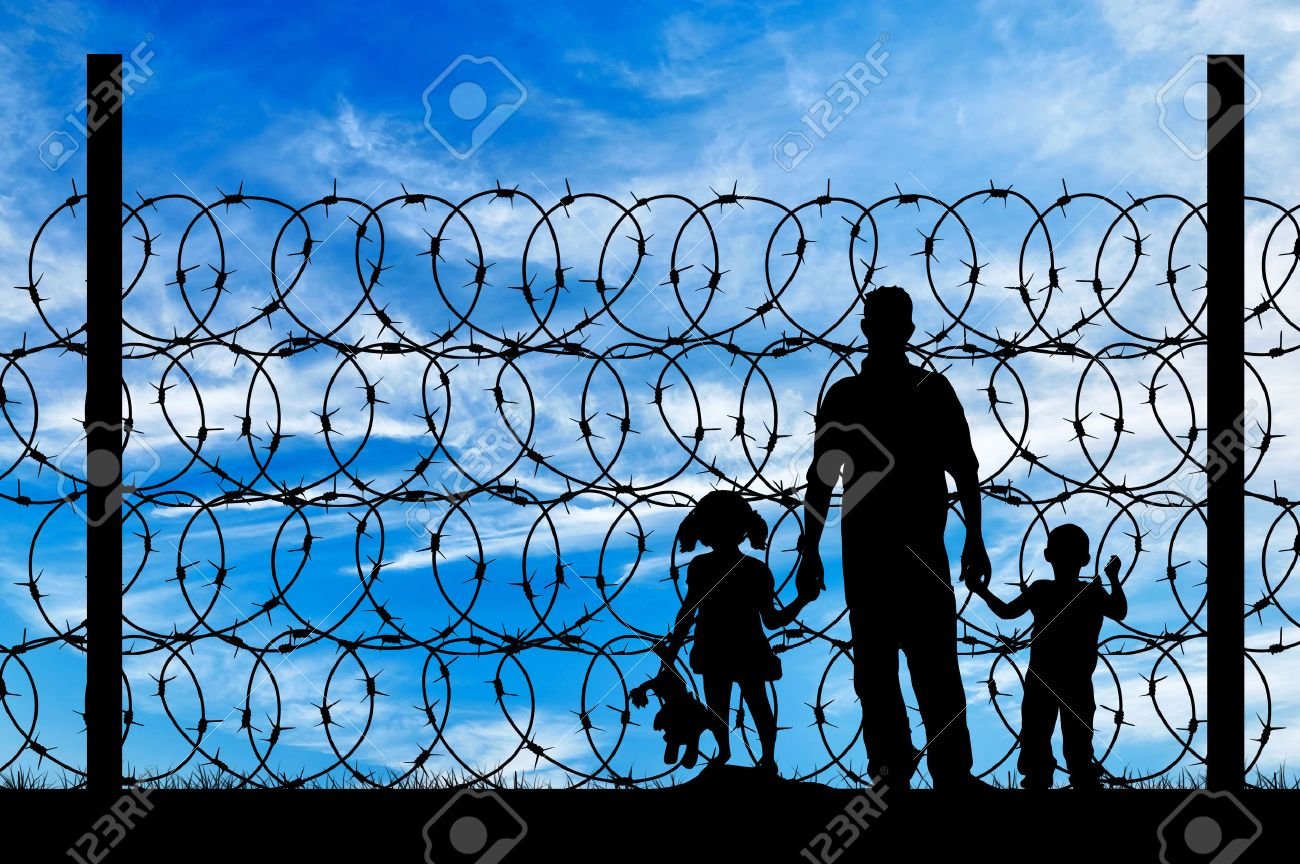 Silhouette Of A Family With Children Of Refugees And Fence With ...