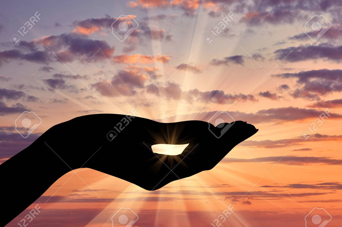 Concept of emotions and feelings. Silhouette helping hand gesture on sunset background - 52347698