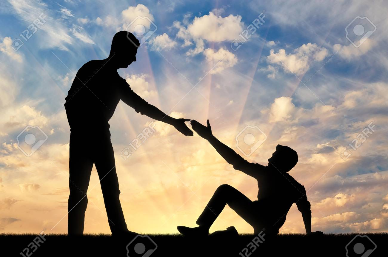 Silhouette Of A Man Giving A Helping Hand To Another Man Who.. Stock Photo,  Picture And Royalty Free Image. Image 101738202.