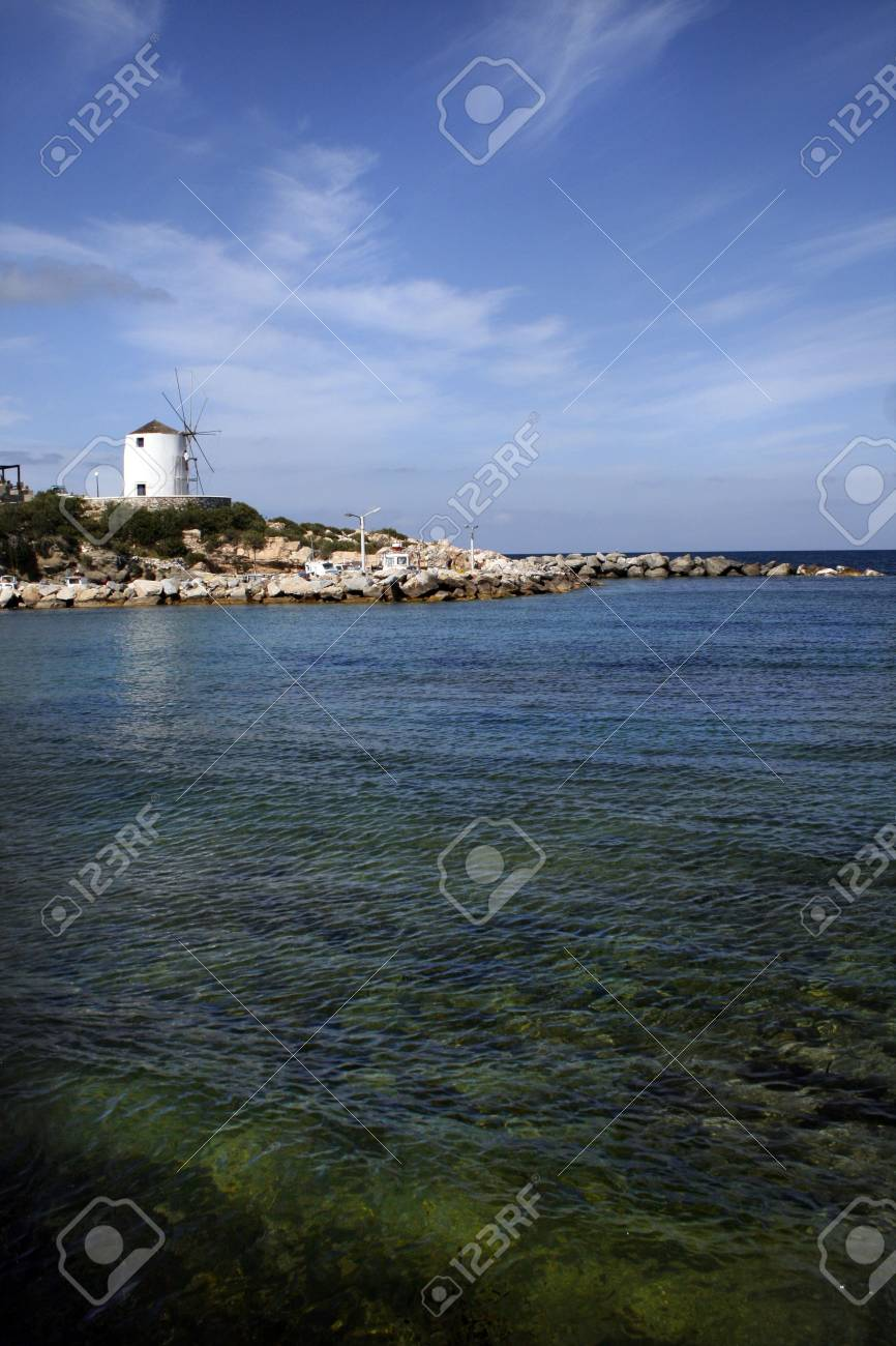 Beach on Paros Island with view of windmill - Greece Stock Photo - 2020879