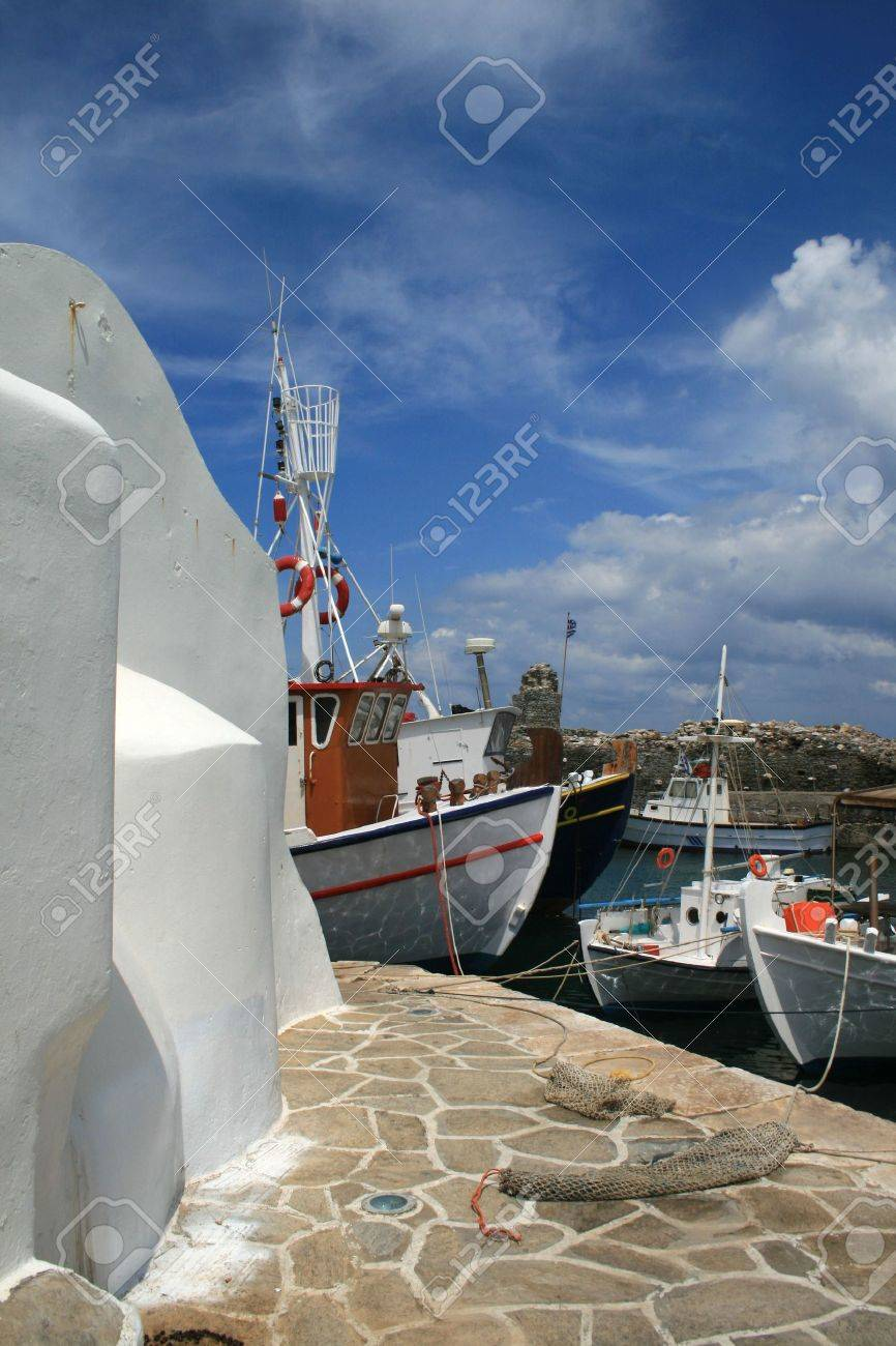 Paros, Greece: church and fishing boats from the old harbor of the town of Naoussa Stock Photo - 2958282