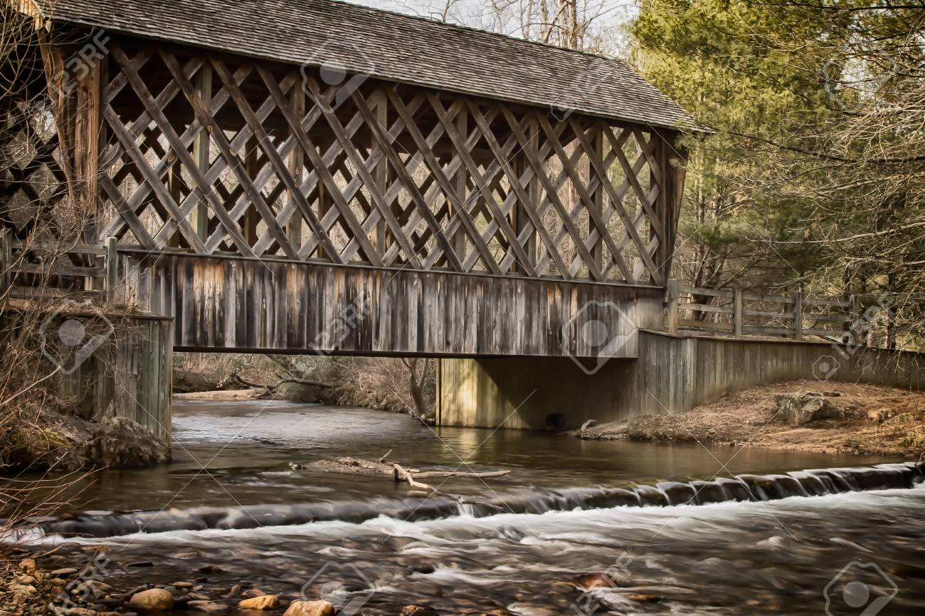 Covered Wooden Bridge Over Creek In The Fall