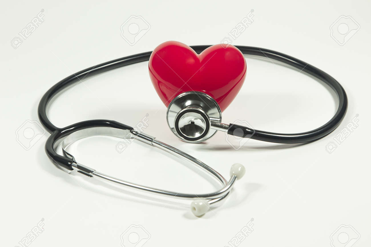 Red heart and a stethoscope on isolated white background. - 152355240