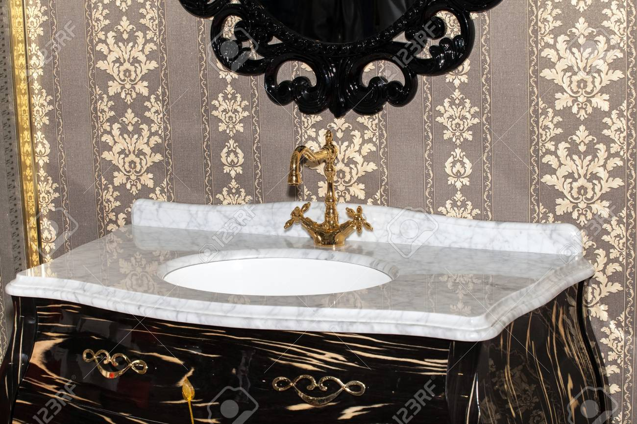 Retro Style Bathroom Detail View Of Ceramic Bath Sink With Gold Faucet Stock Photo Picture And Royalty Free Image Image 56738948