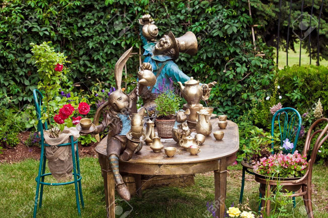 Background Of Garden Design. Landscaping In Park With Fountain On Theme Of Alice  In Wonderland