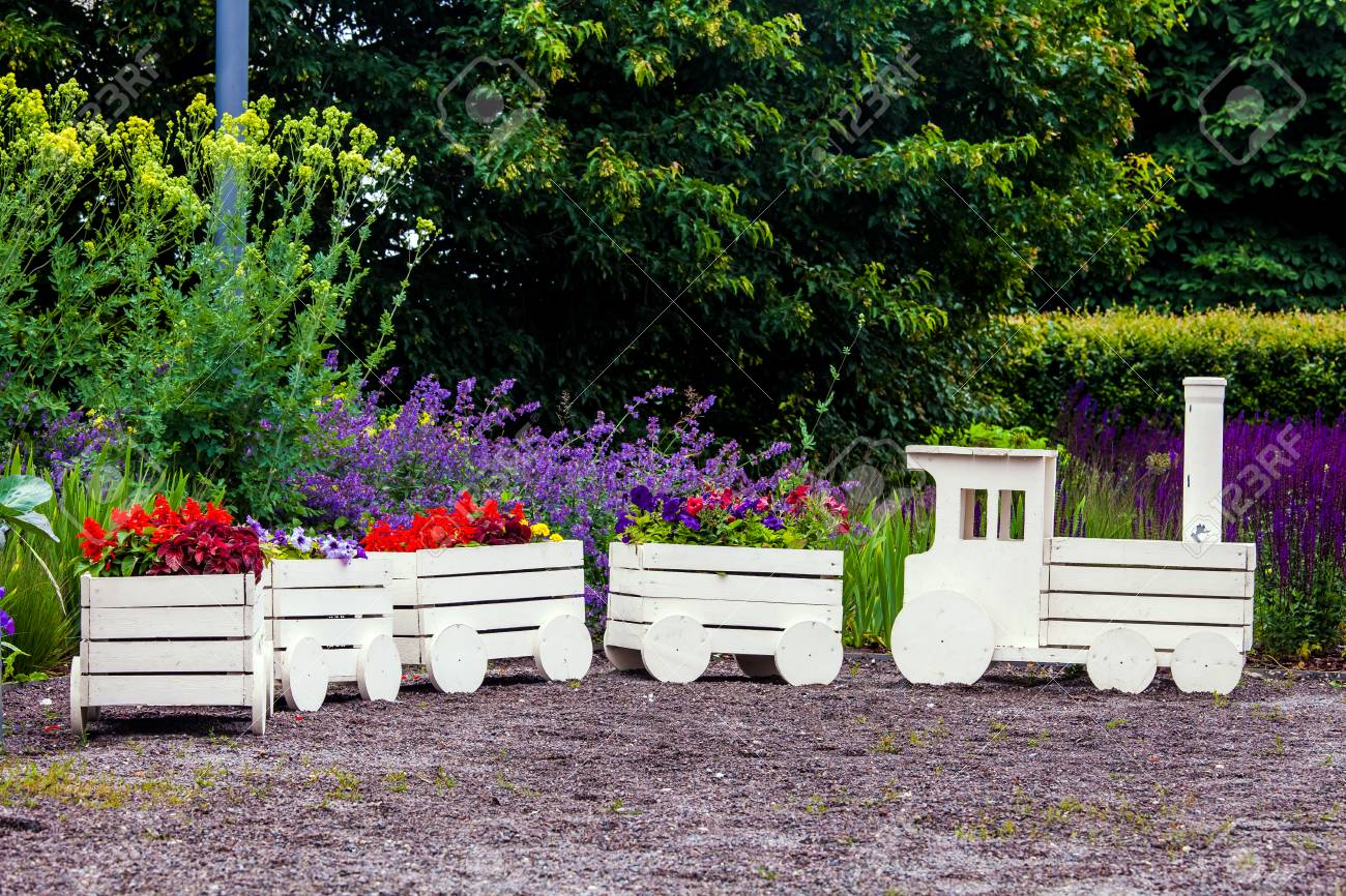 Landscape Flower Gardening Background Train And Wooden Wagon Stock Photo Picture And Royalty Free Image Image 83815121