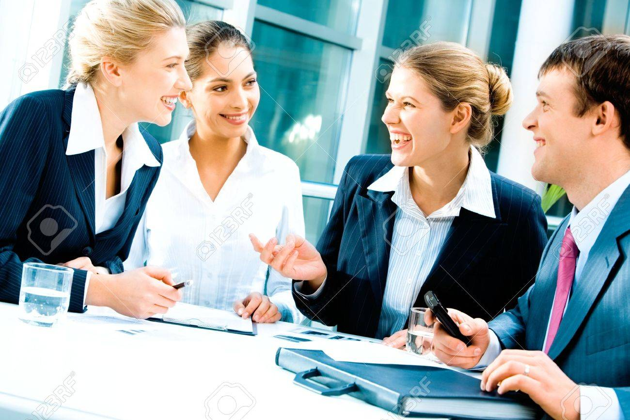 Image of laughing confident people planning a business-strategy Stock Photo - 2455745