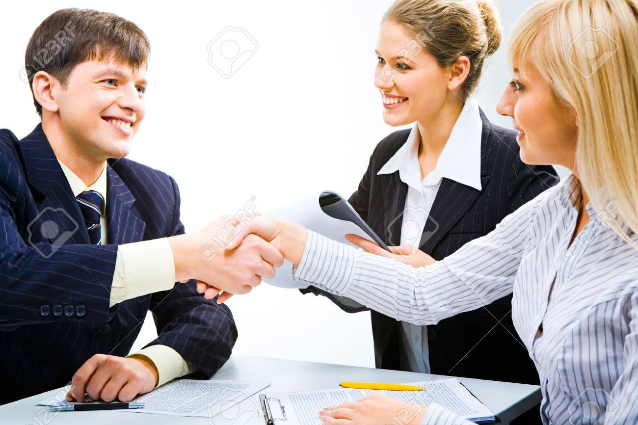 Business partners shaking hands and looking at each other at meeting Stock Photo - 2455731