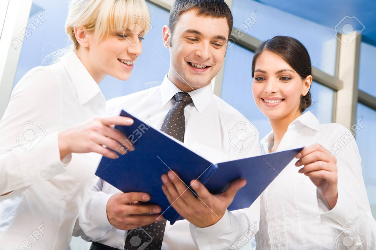 Three business people met together to discuss important questions Stock Photo - 2506981