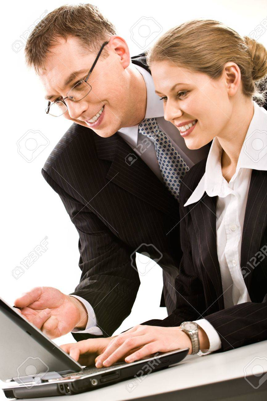 Successful business team of two people working over a laptop Stock Photo - 2507065