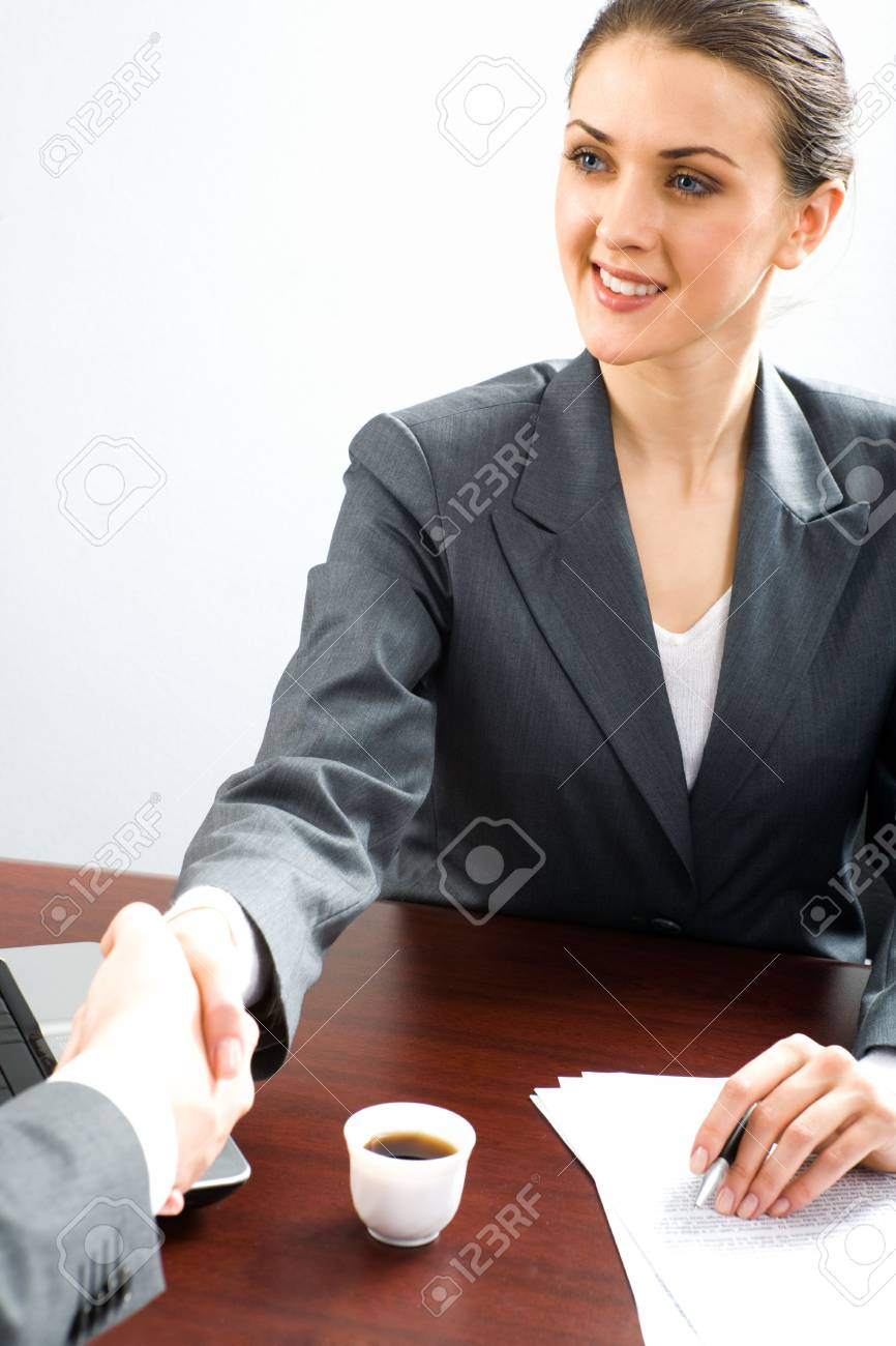 Creative image of business woman making an agreement with her partner Stock Photo - 2513169