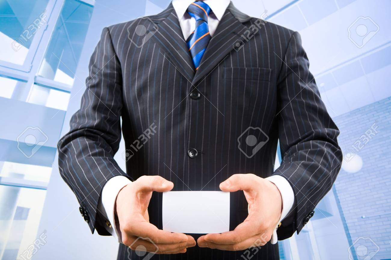 Photo of business man holding his visiting card in the office Stock Photo - 2513156