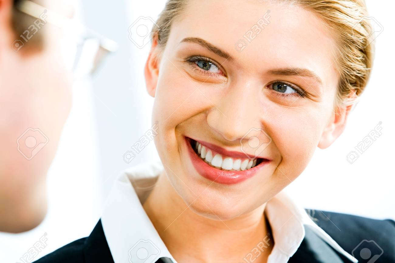 Portrait of young smiling  woman gazing at business man Stock Photo - 2553663