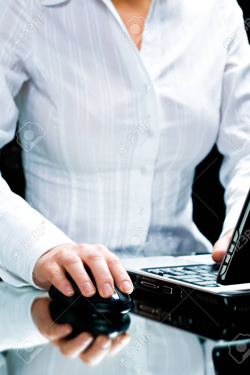 Image of businesswoman touching a computer mouse Stock Photo - 2602344
