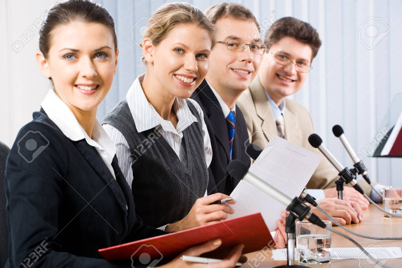 Portrait of four confident professionals sitting at the table and looking at camera Stock Photo - 2641018