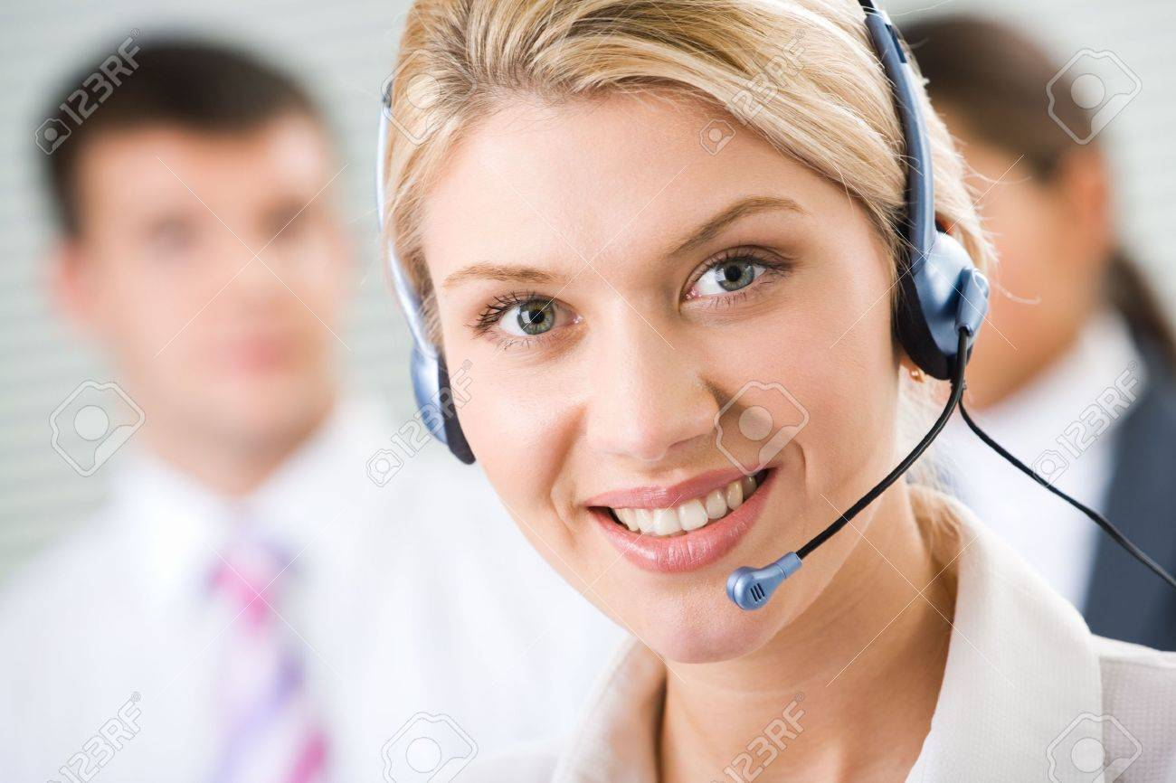Face of young charming confident woman with headset Stock Photo - 2641004