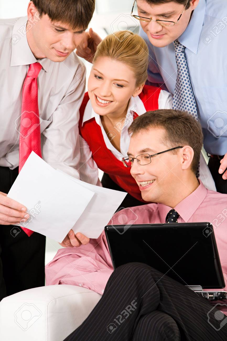 Business man showing an important document to his co-workers Stock Photo - 2644947