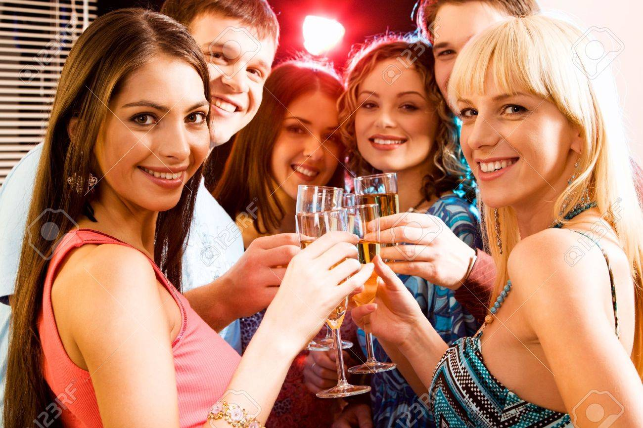 Portrait of group of smiling young people enjoying cocktails Stock Photo - 2644781