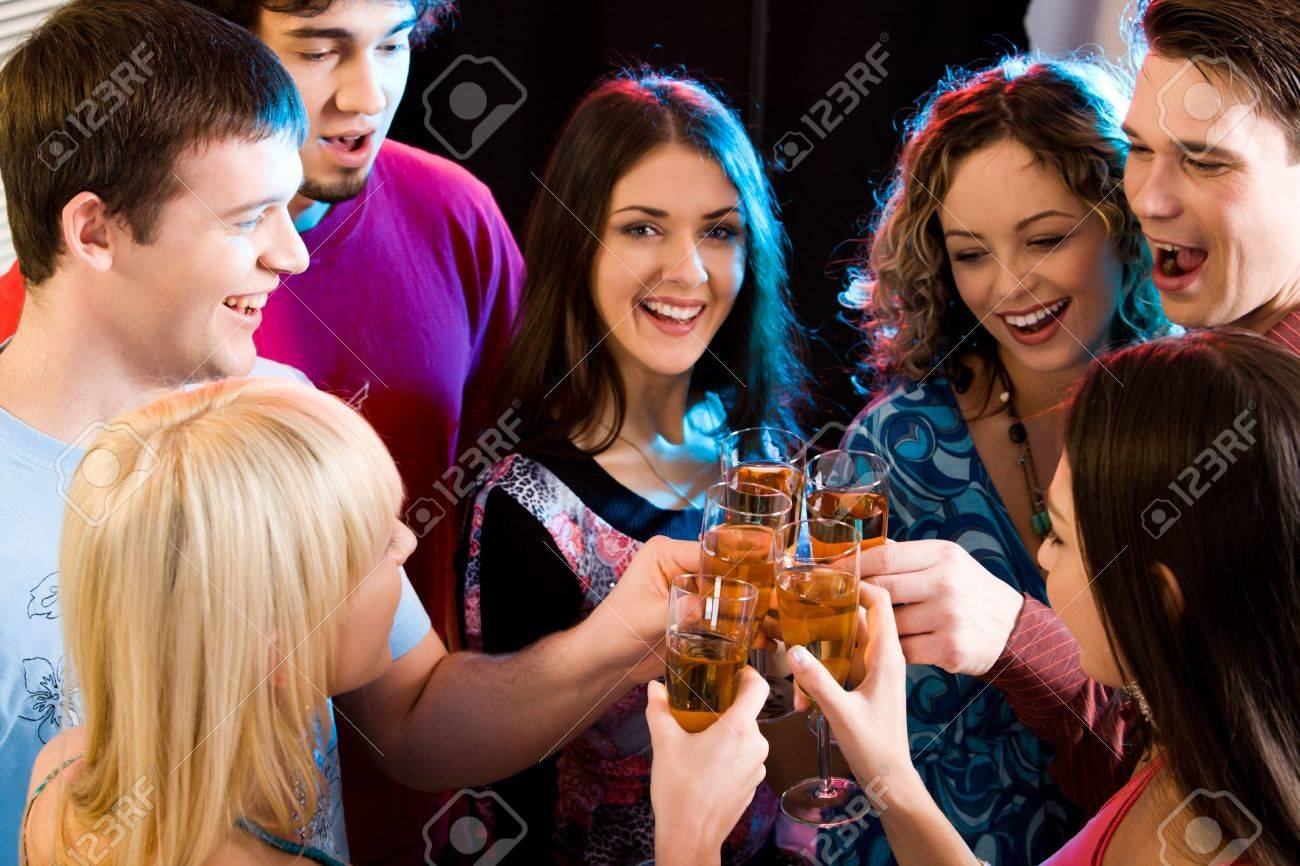 Group are holding the glasses of champagne making a toast Stock Photo - 2644756