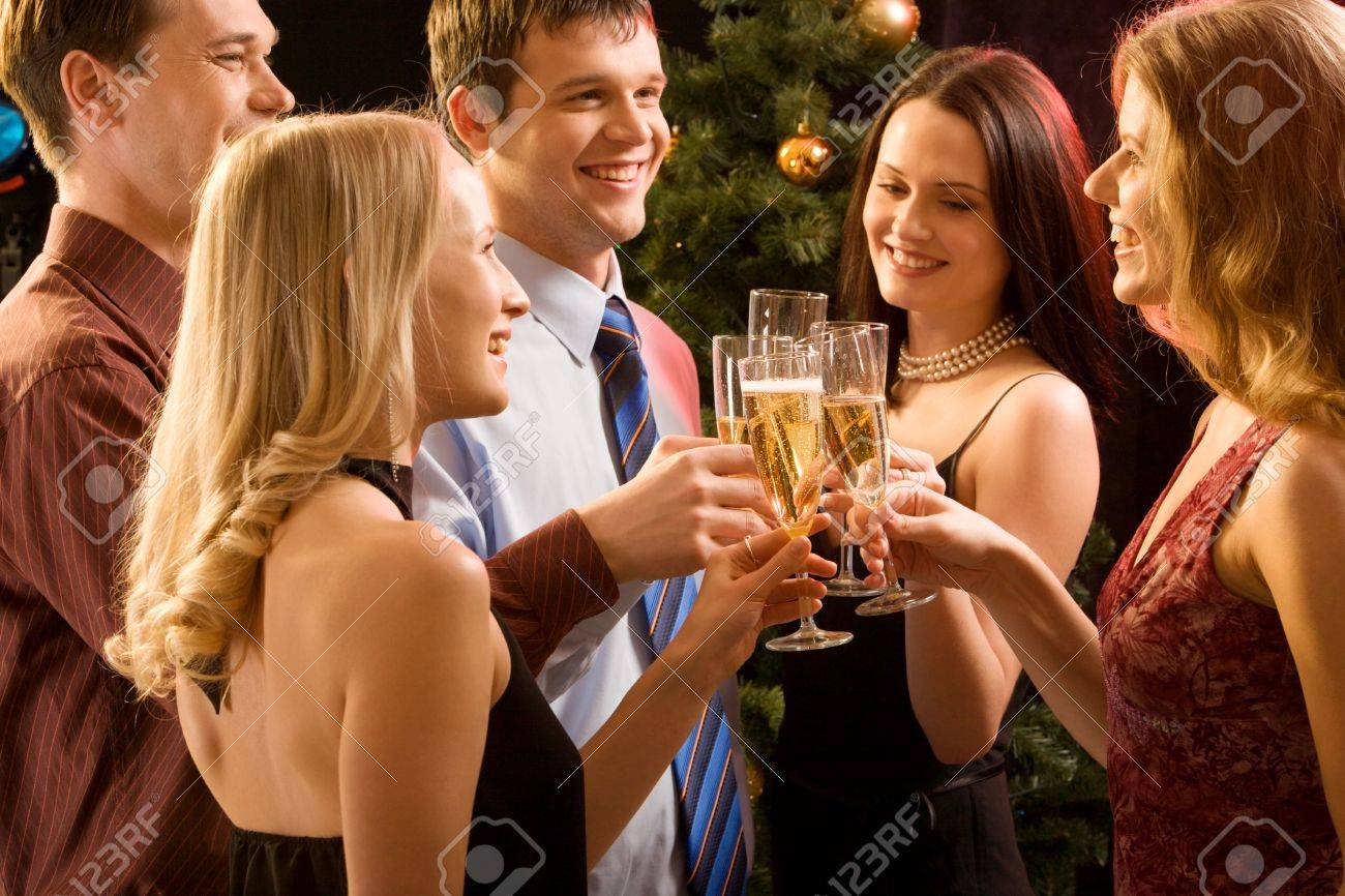 Group of  people  raising up bocals of champagne making a toast Stock Photo - 2644785