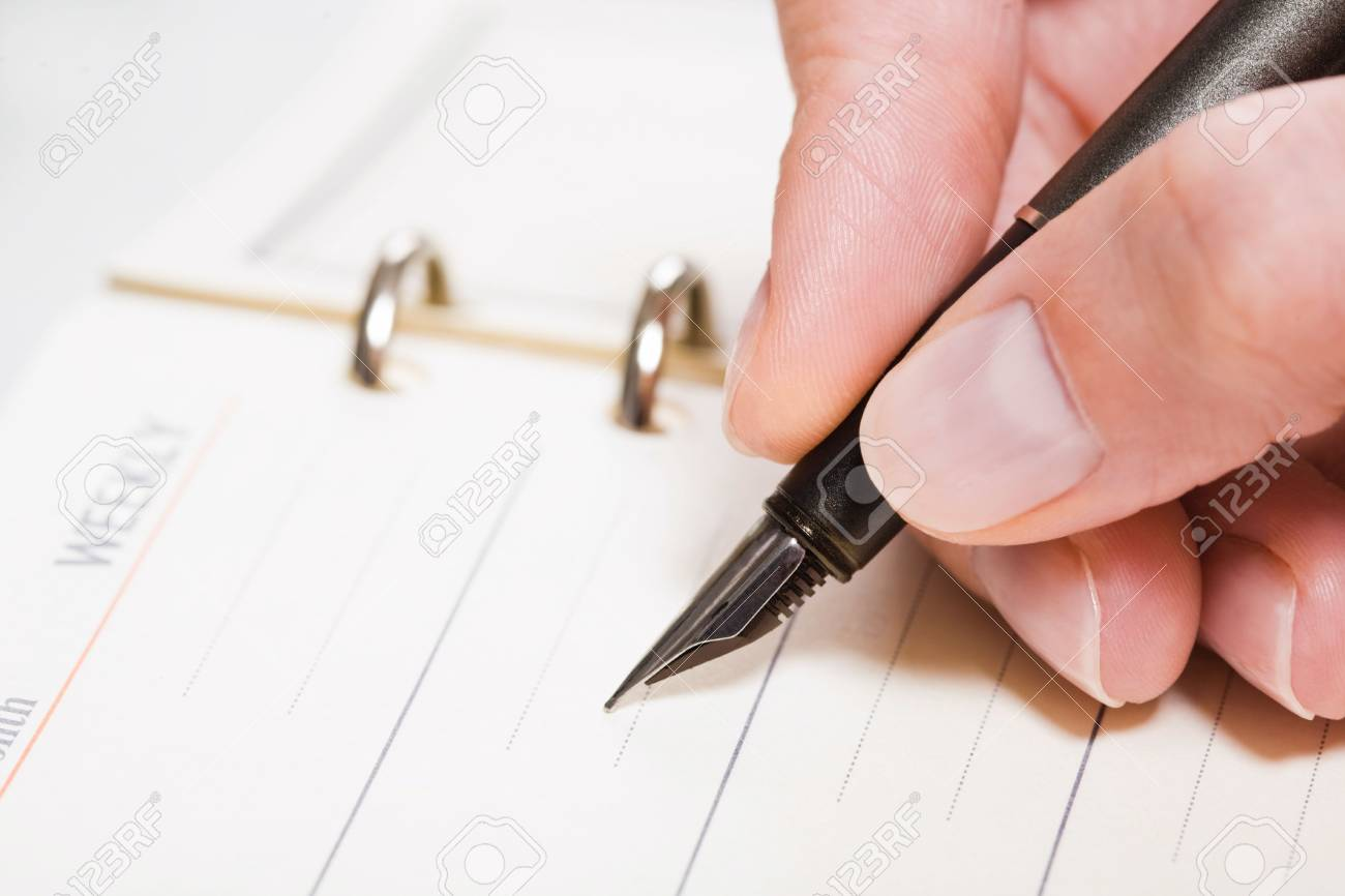 Close-up of a human hand holding the fountain-pen Stock Photo - 2657521