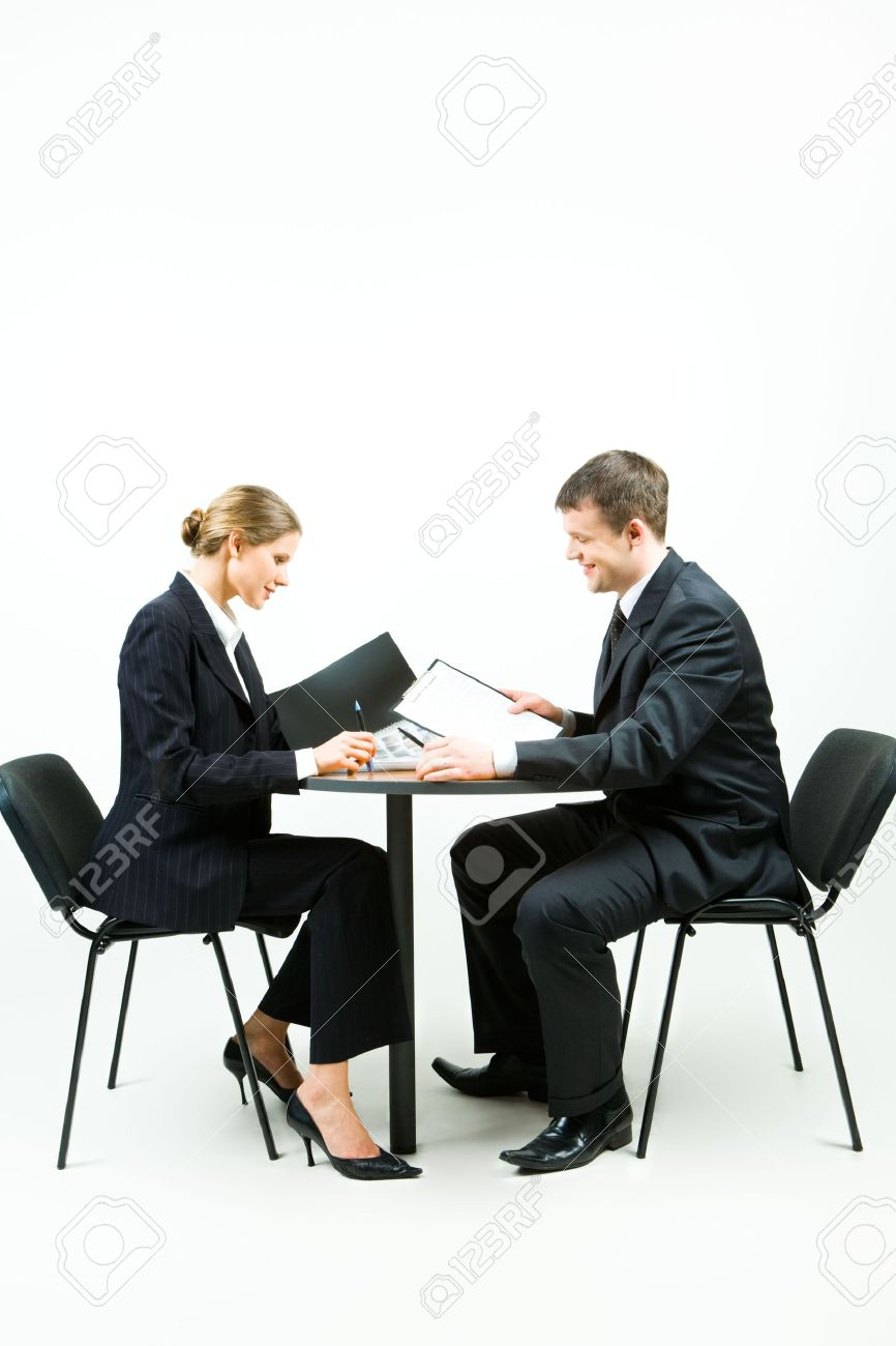 people sitting at table white background. image of two business people in suit sitting at the table on a white background stock e
