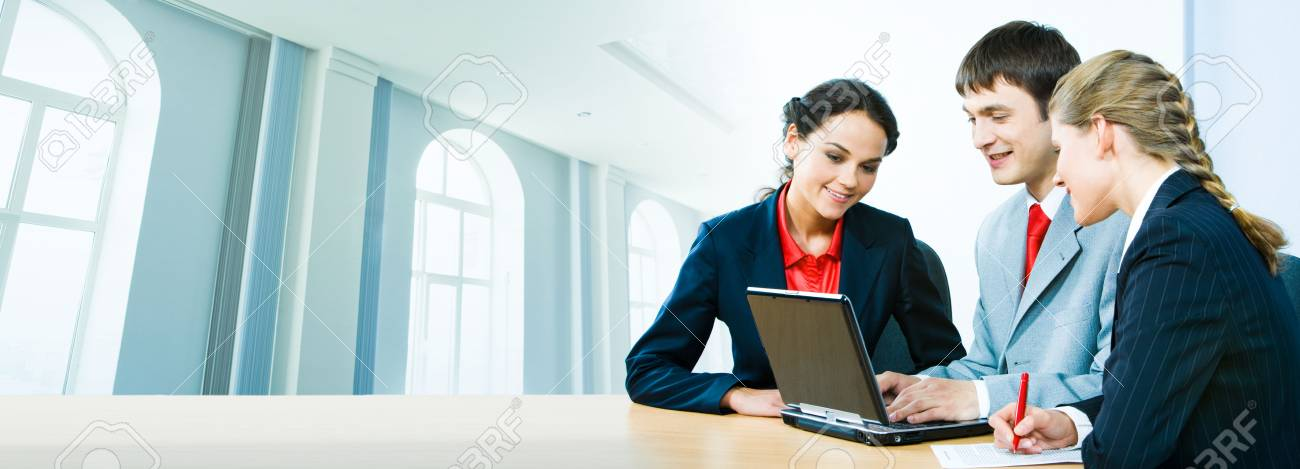 Portrait of business people interacting together on the background of office building Stock Photo - 2885482